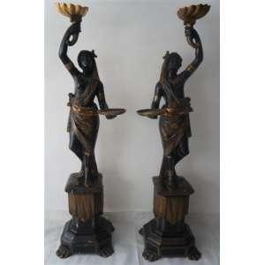 Par de elegantes Black Moore executados em madeira lavrada ricamente policromada .Itália Séc XIX. - Com base 180 cm alt, sem base cm 130 de alt.